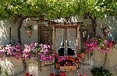France, Aquitaine, Lot-et-Garonne, Pujols, flower-bedecked facade of house