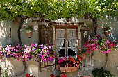 France, Aquitaine, Lot-et-Garonne, Pujols, flower-bedecked facade of house