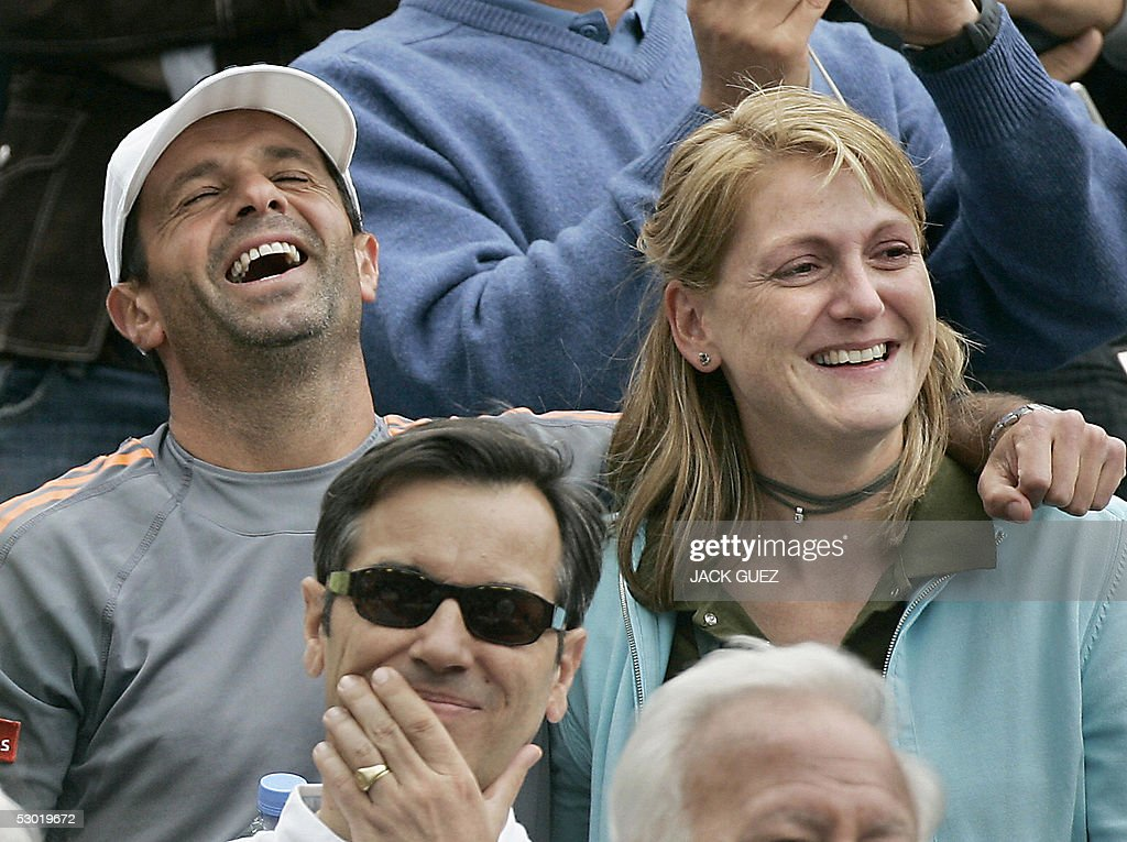 Argentinian Carlos Rodriguez coach of Belgium Justine HeninHardenne smiles after the women's final match of the tennis French Open at Roland Garros...