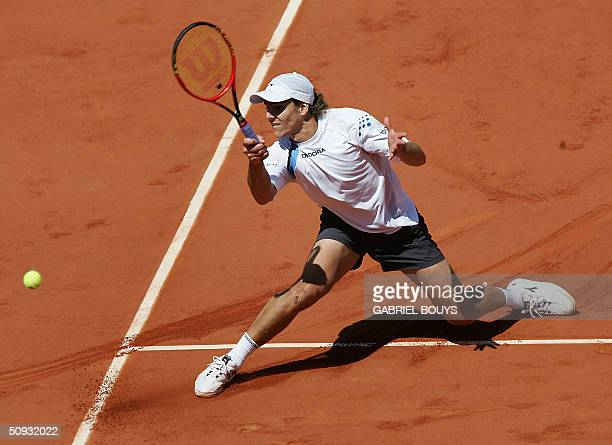 Argentinian Gaston Gaudio hits a shot to Argentinian Guillermo Coria in their men's final match during the French Open at Roland Garros in Paris 06...