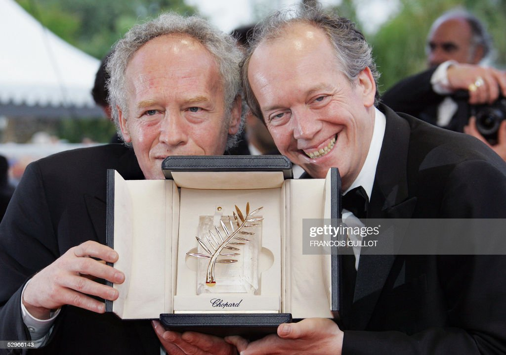 Belgian directors Jean-Pierre (L) and Luc Dardenne pose with their Palme d'Or as they arrive for the closing ceremony of the 58th edition of the Cannes International Film Festival on the French Riviera 22 May 2005. Belgian directors Jean-Pierre and Luc Dardenne won the Palme d'Or for their film 'L'Enfant' (The Child) 21 May.