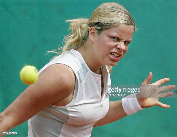 Belgium Kim Clijsters eyes the ball after returning it to US Lindsay Davenport during their fourth round match of the tennis French Open at Roland...