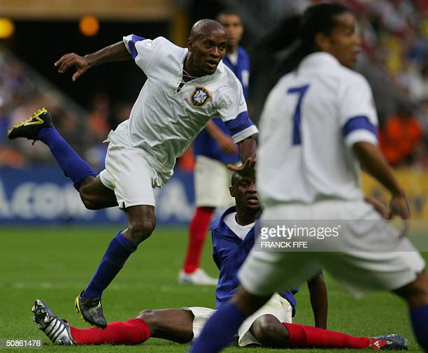 Brazil's defender Roberto Carlos breaks away during the FIFA Centenary football match between France and Brazil 20 May 2004 at the Stade de France in...