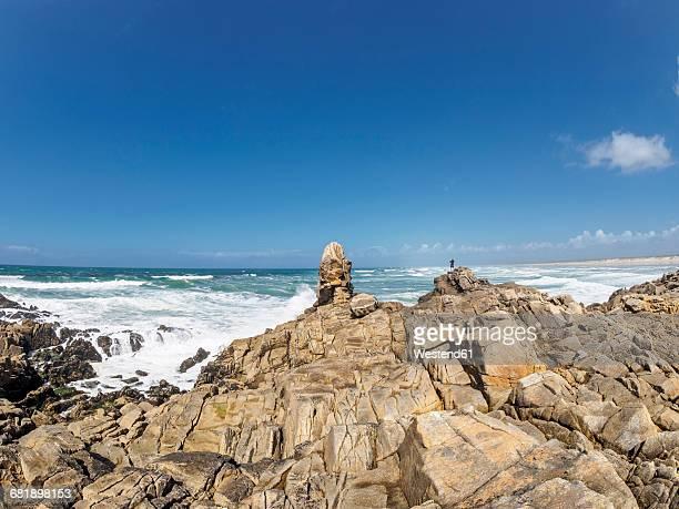 France, Bretagne, Finistere, Man standing at Atlantic coast