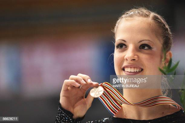 Bronze medallist Italy's Carolina Kostner celebrate on the podium after the Ladies Free Skating competition during the European Figure Skating...