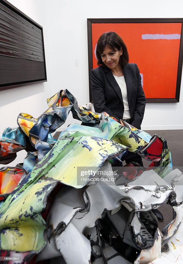 CAPTION France' candidate for the 2014 mayoral elections in Paris and Paris socialist deputy mayor Anne Hidalgo looks at a work by US artist John Chamberlain , on October 26, 2013 during a visit at the FIAC, the International Contemporary Art Fair at Le Grand Palais in Paris. The event runs from October 24 to October 27, 2013. At left, a painting of French Pierre Soulages.
