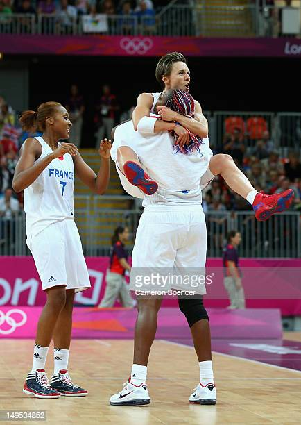 France captain Celine Dumerc celebrates with team mate Isabelle Yacoubou after winning the Women's Basketball Preliminary Round match between...