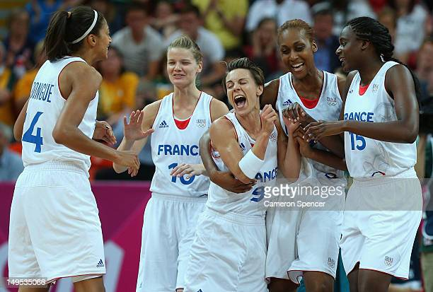 France captain Celine Dumerc celebrates with team mates after winning the Women's Basketball Preliminary Round match between Australia and France on...