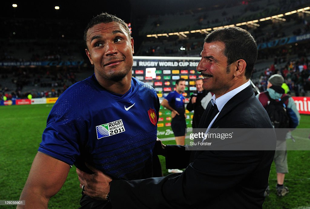 France captain <a gi-track='captionPersonalityLinkClicked' href=/galleries/search?phrase=Thierry+Dusautoir&family=editorial&specificpeople=544025 ng-click='$event.stopPropagation()'>Thierry Dusautoir</a> (L) celebrates with his head coach <a gi-track='captionPersonalityLinkClicked' href=/galleries/search?phrase=Marc+Lievremont&family=editorial&specificpeople=2726997 ng-click='$event.stopPropagation()'>Marc Lievremont</a> (R) following their team's 9-8 defeat during semi final one of the 2011 IRB Rugby World Cup between Wales and France at Eden Park on October 15, 2011 in Auckland, New Zealand.