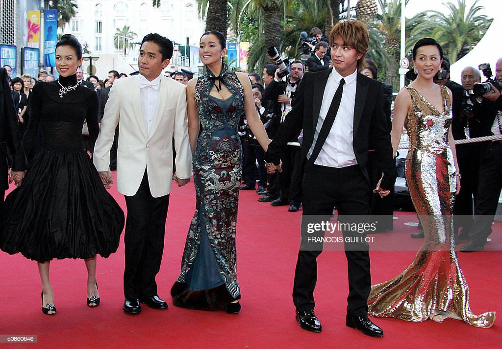 Chinese actress Zhang Ziyi, Hong kong actor Tony Cheung, Chinese actress Gong Li, Japanese actor Takuya Kimura and Hong Kong actress Maggie Cheung arrive for the official projection of Chinese director Wong Kar-Wai's '2046', 20 May 2004, at the 57th Cannes Film Festival. China's lone entry in the festival's official competition for the prestigious Palme D'Or is a poetic film that was five years in the making.