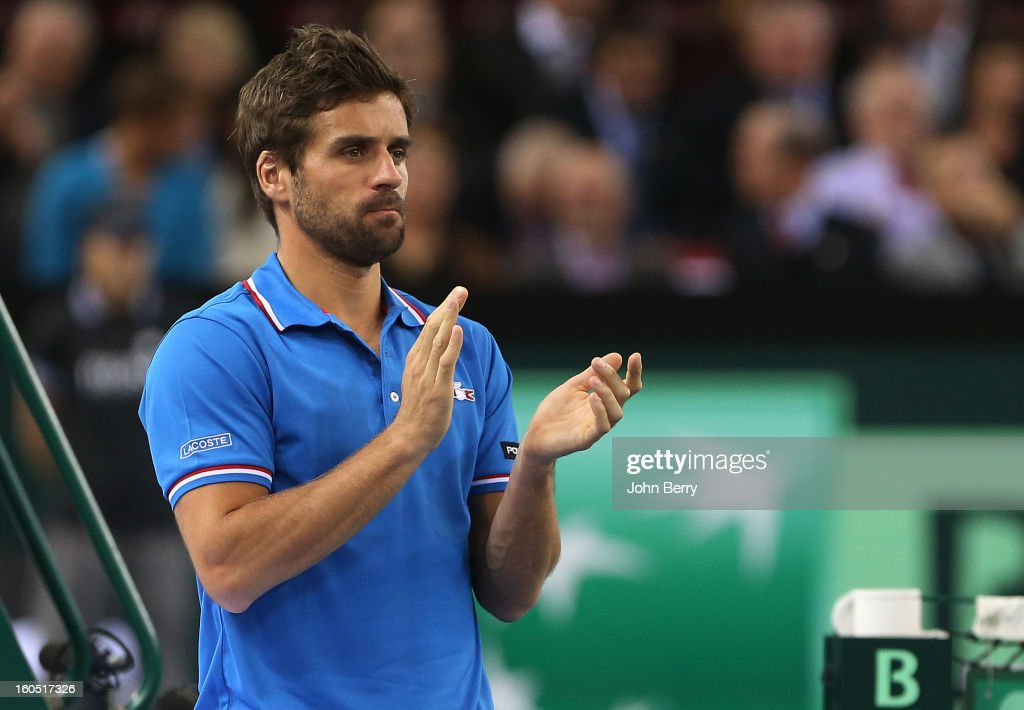 France coach Arnaud Clement applauds during the first round match between Richard Gasquet France and Dudi Sela of Israel on day one of the Davis Cup at the Kindarena stadium on February 1, 2013 in Rouen, France.