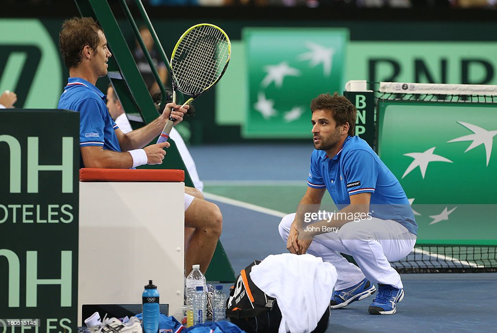 France coach Arnaud Clement shares few words with Richard Gasquet of France (L) during his match against Dudi Sela of Israel on day one of the Davis Cup first round match between France and Israel at the Kindarena stadium on February 1, 2013 in Rouen, France.