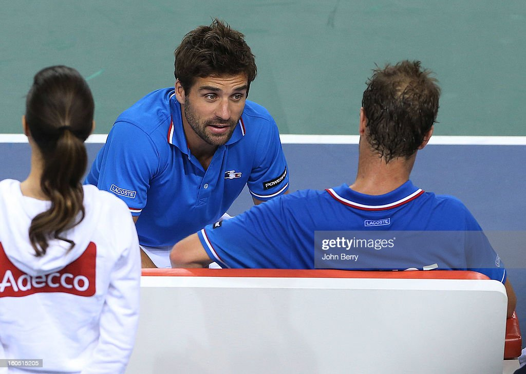 France coach Arnaud Clement (L) shares few words with Richard Gasquet of France during his match against Dudi Sela of Israel on day one of the Davis Cup first round match between France and Israel at the Kindarena stadium on February 1, 2013 in Rouen, France.
