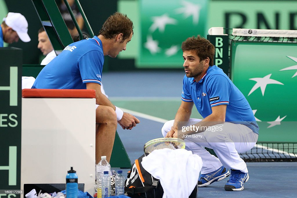 France coach Arnaud Clement (R) shares few words with Richard Gasquet of France (seating) during his match against Dudi Sela of Israel on day one of the Davis Cup first round match between France and Israel at the Kindarena stadium on February 1, 2013 in Rouen, France.