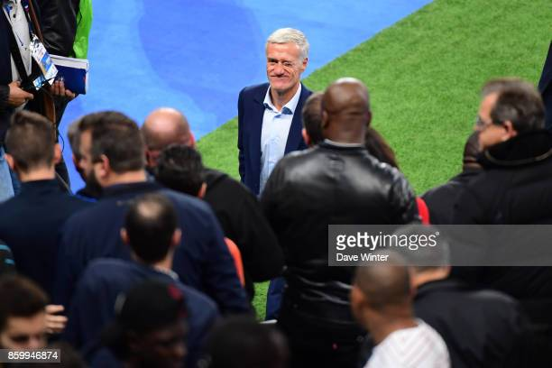 France coach Didier Deschamps winks to someone in the crowd after the Fifa 2018 World Cup qualifying match between France and Belarus on October 10...