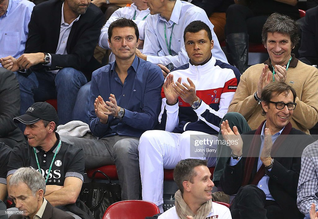 France coach Eric Winogradsky and Jo-Wilfried Tsonga of France (2nd R) applaud during the first round match between Richard Gasquet France and Dudi Sela of Israel on day one of the Davis Cup at the Kindarena stadium on February 1, 2013 in Rouen, France.