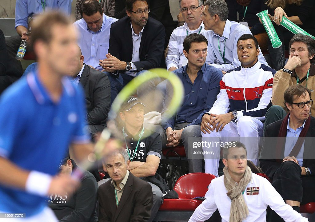 France coach Eric Winogradsky and Jo-Wilfried Tsonga of France (2nd R) looks on during the first round match between Richard Gasquet France and Dudi Sela of Israel on day one of the Davis Cup at the Kindarena stadium on February 1, 2013 in Rouen, France.