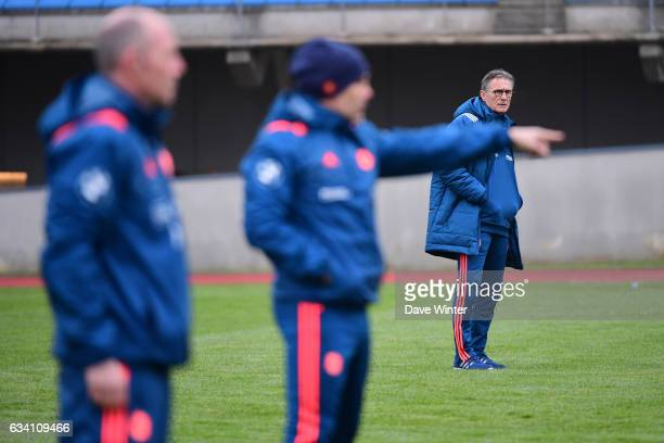 France coach Guy Noves watches as France defence coach Gerald Bastide and France forwards coach Yannick Bru conduct the training session of the...