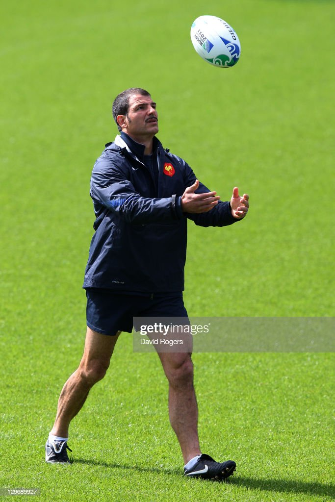 France coach <a gi-track='captionPersonalityLinkClicked' href=/galleries/search?phrase=Marc+Lievremont&family=editorial&specificpeople=2726997 ng-click='$event.stopPropagation()'>Marc Lievremont</a> eyes the ball during a France IRB Rugby World Cup 2011 training session at Onewa Domain on October 20, 2011 in Takapuna, New Zealand.