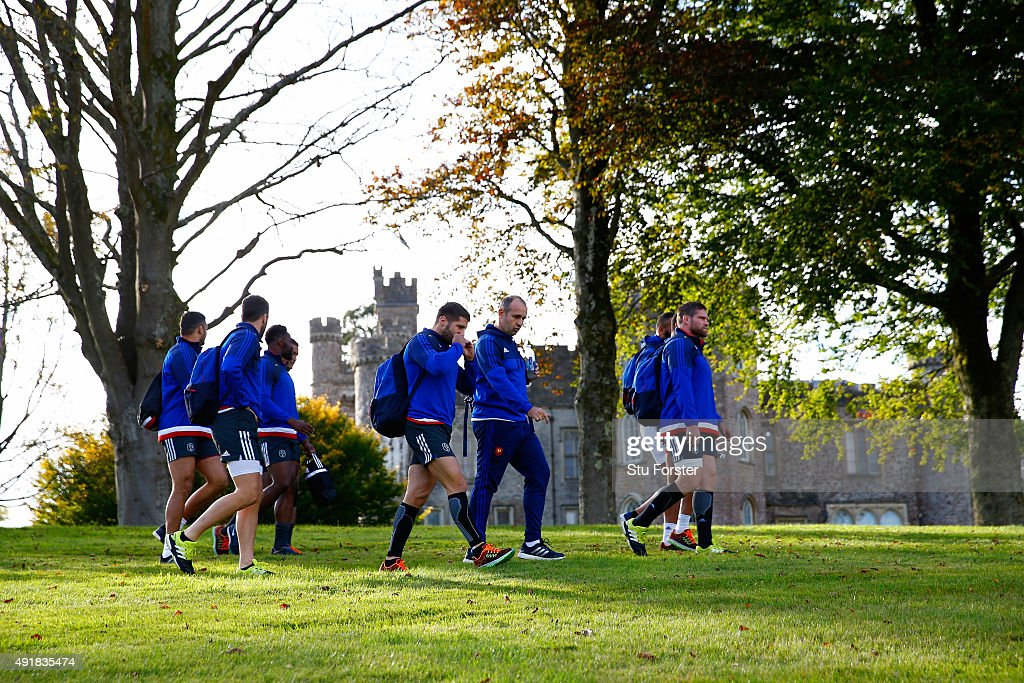 France coach Phillipe Saint-Andre (c) and his players make their way to training past Hensol Castle on October 8, 2015 in Cardiff, Wales.