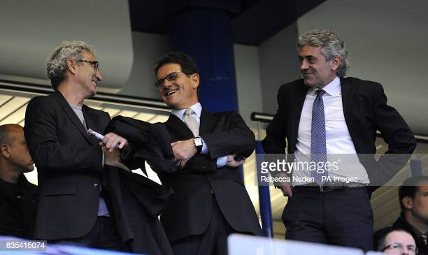 France coach Raymond Domenech England coach Fabio Capello and England general manager Franco Baldini in the stands