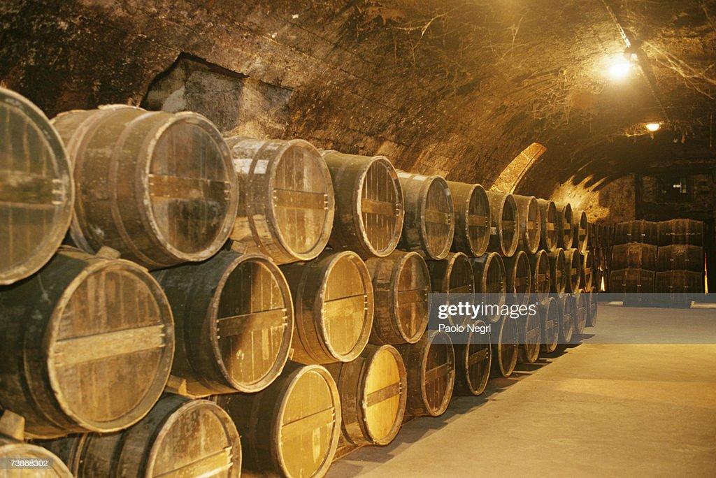 France, Cognac, Otard distillery, Rows of kegs in cellar : Stock Photo