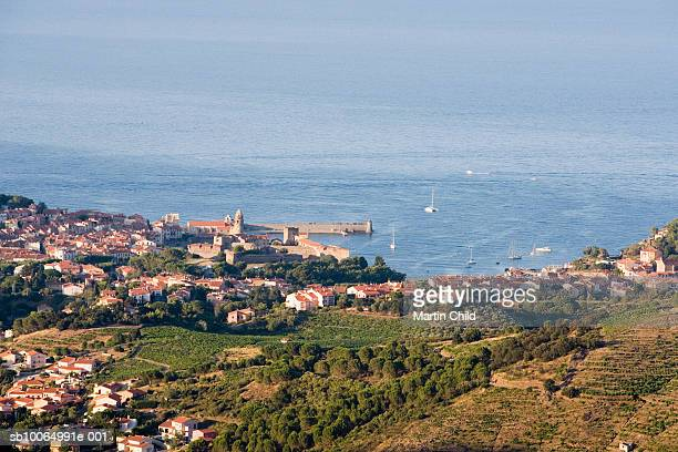 France, Collioure, houses on hills descending towards sea, elevated view