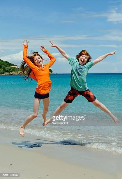 France, Corsica, Favone, children having fun at a beach