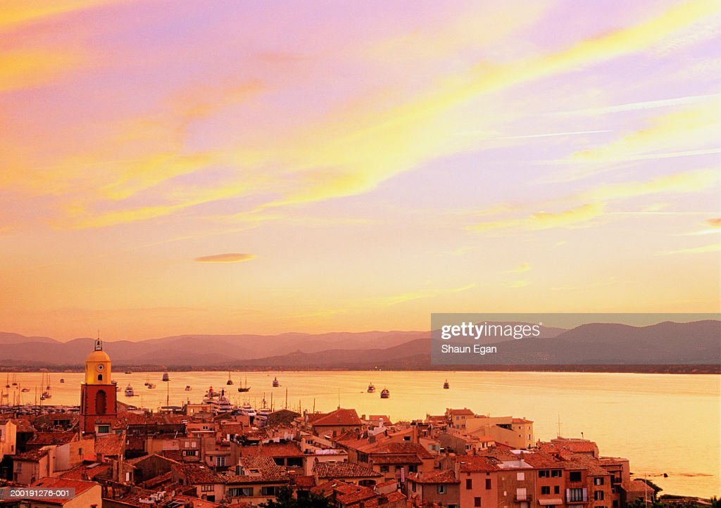 France, Cote d'Azur, St Tropez, town and bay, dusk