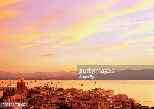 France, Cote d'Azur, St Tropez, town and bay, dusk