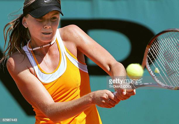 Daniela Hantuchova from Slovakia returns the ball to Belgium Kim Clijsters during their third round match of the tennis French Open at Roland Garros...