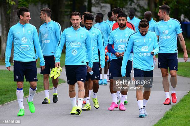 France defender Laurent Koscielny defender Mathieu Debuchy and forward Nabil Fekir arrive a training session at the French national football team...