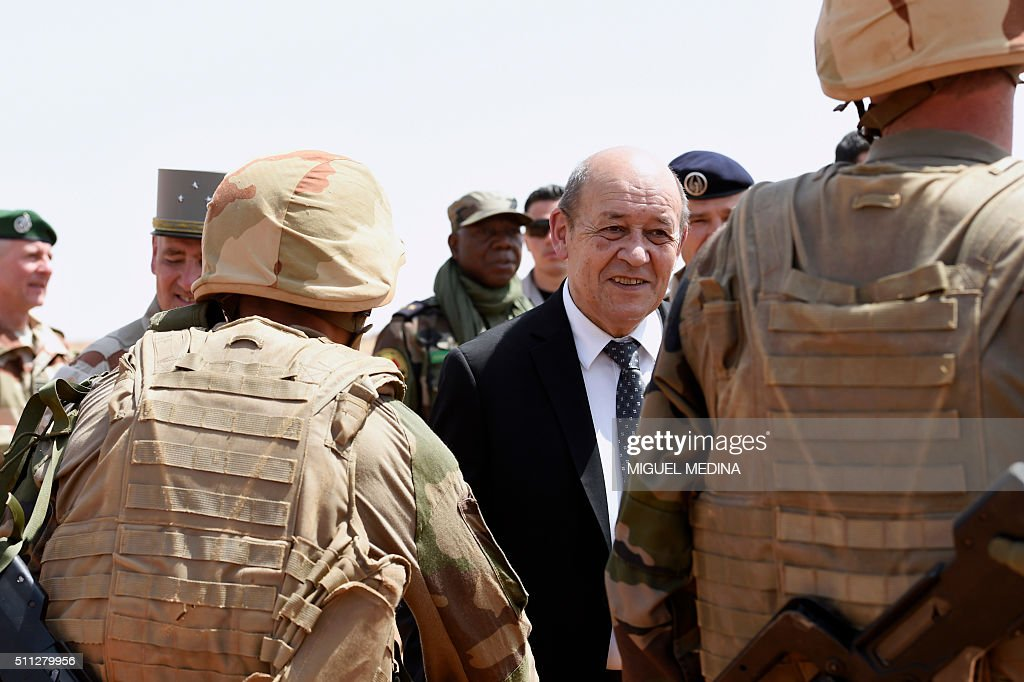 France Defense Minister JeanYves Le Drian salutes soldiers during a visit to the troops of France's Barkhane counterterrorism operation in Africa's...