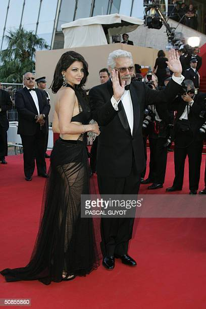 Egyptian actor Omar Sharif and Lebanese exmodel and singer Haifa Wehbi arrives for the official projection of the Cohen brothers' film 'Ladykillers'...