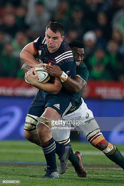France eighth man Louis Picamoles is takled by South Africa flanker Siya Kolisi during the third rugby union Test match between South Africa and...