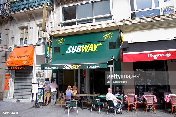 France Europe French Paris 2nd arrondissement Rue SaintDenis Subway sandwiches sub shop restaurant tables chairs outside exterior