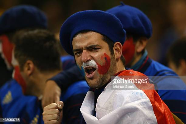 France fan looks forward to the action ahead of the 2015 Rugby World Cup Quarter Final match between New Zealand and France at the Millennium Stadium...