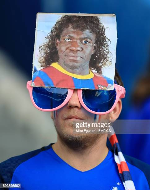 A France fan shows his support for new Barcelona signing Samuel Umtiti in the stands before the game