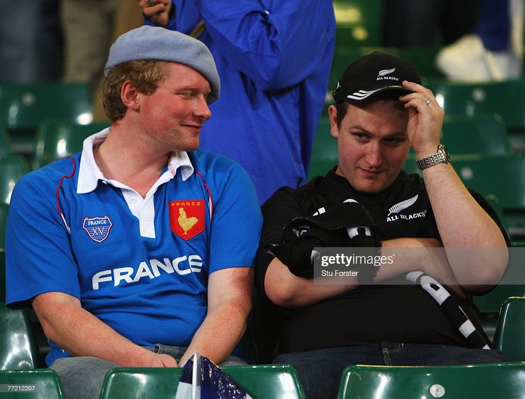 France fan smiles as a New Zealand fan is dejected following the Quarter Final of the Rugby World Cup 2007 match between New Zealand and France at...
