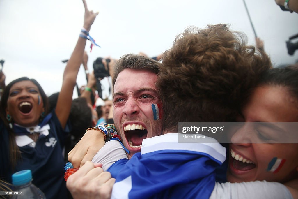 France fans celebrate in the second half of their 2014 FIFA World Cup match against Nigeria while watching at FIFA Fan Fest on Copacabana Beach on June 30, 2014 in Rio de Janeiro, Brazil. France advances to the quarterfinals.