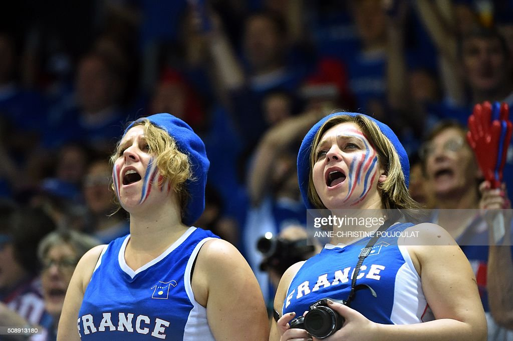 France fans cheer during the Fed Cup World Group first round tennis match between France and Italy in Marseille, southern France, on February 7, 2016. / AFP / ANNE-CHRISTINE POUJOULAT