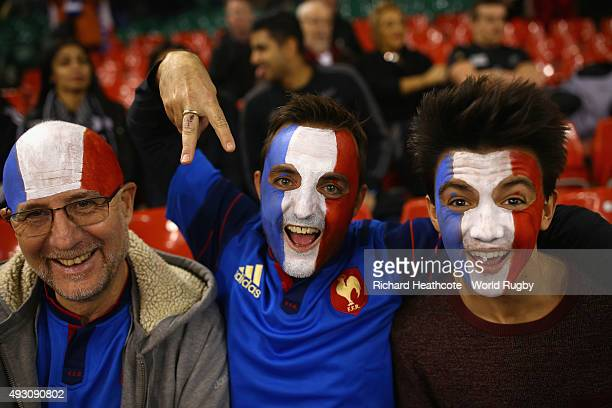 France fans enjoy the atmosphere ahead of the 2015 Rugby World Cup Quarter Final match between New Zealand and France at the Millennium Stadium on...