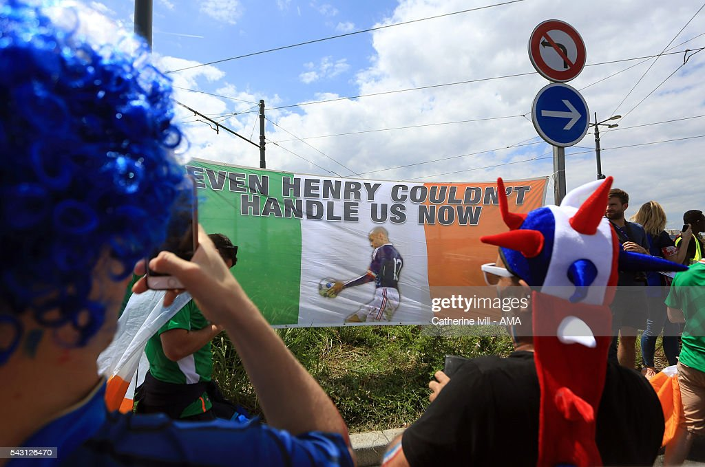 France fans take photos of Irish flag with a picture of the Thierry Henry handball before the UEFA EURO 2016 Round of 16 match between France and Republic of Ireland at Stade des Lumieres on June 26, 2016 in Lyon, France.