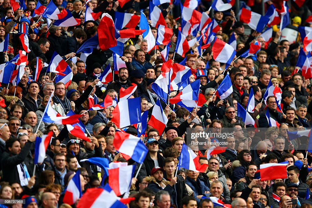 France fans wave the national flag during the RBS Six Nations match between France and Italy at Stade de France on February 6, 2016 in Paris, France.