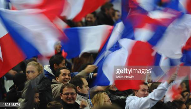 France fans wave the tricolor during the International Friendly between France and USA at Stade de France on November 11 2011 in Paris France