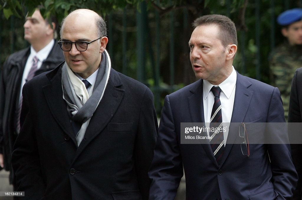 France Finance Minister <a gi-track='captionPersonalityLinkClicked' href=/galleries/search?phrase=Pierre+Moscovici&family=editorial&specificpeople=667029 ng-click='$event.stopPropagation()'>Pierre Moscovici</a> (L) walks with Greek Finance Minuster <a gi-track='captionPersonalityLinkClicked' href=/galleries/search?phrase=Yannis+Stournaras&family=editorial&specificpeople=9497239 ng-click='$event.stopPropagation()'>Yannis Stournaras</a> on February 19, 2013 in Athens, Greece. French President Francois Hollande arrived in Athens on Tuesday for a brief visit for talks focused on Greece's deep financial crisis.