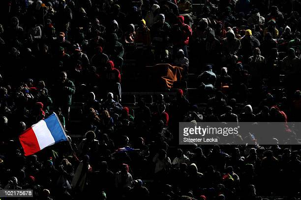 France flag is flown in the crowd during the 2010 FIFA World Cup South Africa Group A match between France and Mexico at the Peter Mokaba Stadium on...
