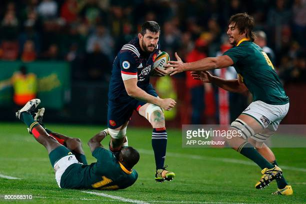 CORRECTION France flanker Loann Goujon is tackled by South Africa winger Raymon Rhule and South Africa captain and lock Eben Etzebeth during the...