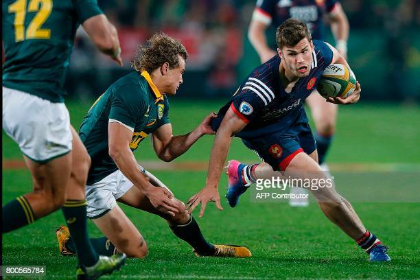 France flyhalf Jules Plisson is tackled by South Africa center Jan Serfontein during the third rugby union Test match between South Africa and France...