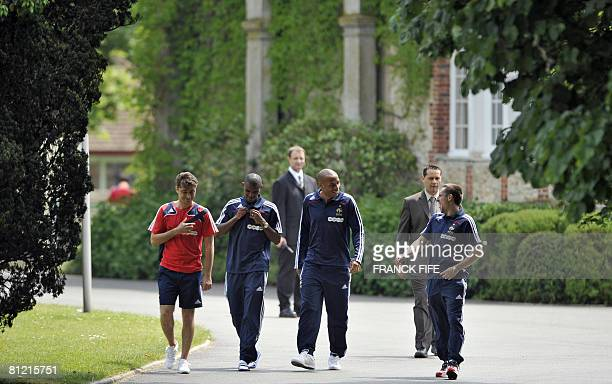 France football team's Franck Ribery Thierry Henry and Eric Abidal arrive to attend a press conference in Clairefontaine southern Paris on May 23 on...